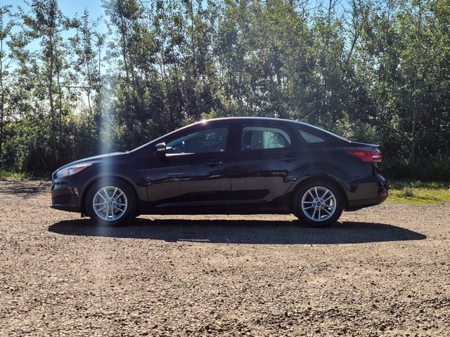 Pre-Owned 2015 Ford Focus SE SEDAN AUTO HTD SEATS
